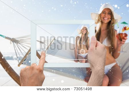 Composite image of hand holding tablet pc against snow
