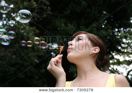 Beautiful Lady Blowing Bubbles