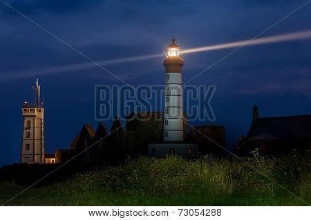 Saint Mathieu lighthouse illuminated at dusk, Brittany, France