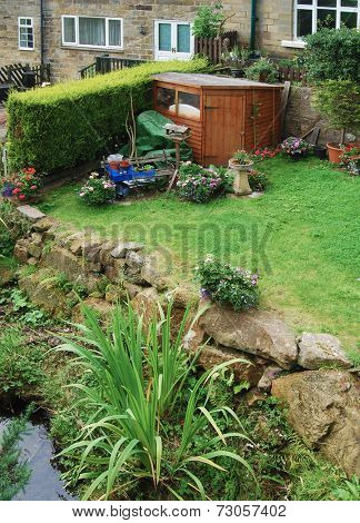View of wooden shed in garden of terraced house