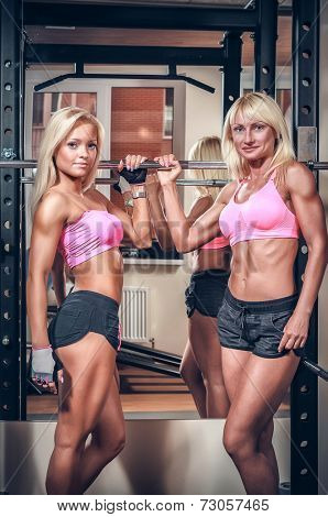 Beautiful athletic women showing muscles