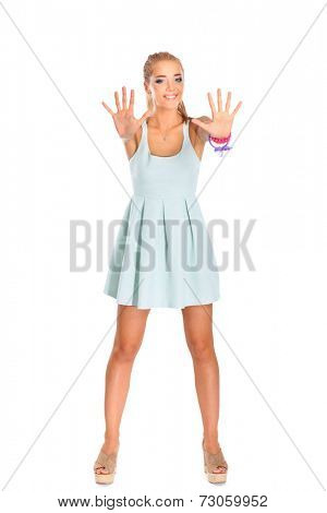 Pretty smiling girl shows ten fingers, isolated on white background