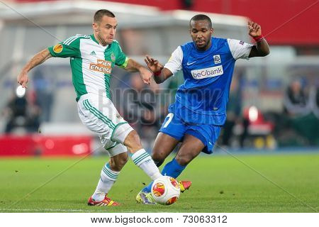 VIENNA, AUSTRIA - NOVEMBER 7 Khaleem Hyland (#7 Genk) and Steffen Hofmann (#11 Rapid) fight for the ball at a UEFA Europa League game on November 7, 2013 in Vienna, Austria.