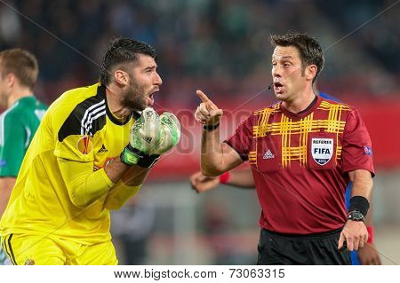 VIENNA, AUSTRIA - NOVEMBER 7 Jan Novota (#1 Rapid) argues with Referee Firat Aydinus (Turkey) at a UEFA Europa League game on November 7, 2013 in Vienna, Austria.