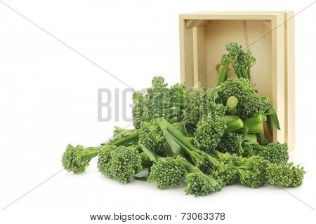 small form of broccoli, called bimi, in a wooden box on a white background