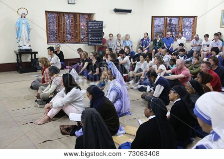 KOLKATA, INDIA - FEBRUARY 15: Sisters of Mother Teresa's Missionaries of Charity and volunteers from around the world at the Mass in the chapel of the Mother House, Kolkata, India at February 15,2014.