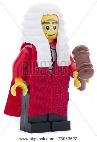 Ankara, Turkey - June 16, 2013 : Lego judge minifigure with judge mullet and court dress  isolated on white background.