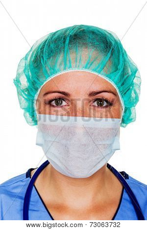 a nurse or doctor in surgical clothes before surgery. symbol photo for stress and overtime at the hospital.