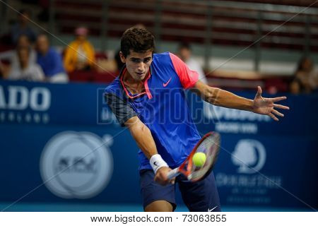 SEPTEMBER 23, 2014 - KUALA LUMPUR, MALAYSIA: Pierre-Hugues Herbert of France makes a backhand return in his first round match at the Malaysian Open Tennis 2014. This is an ATP sanctioned tournament.