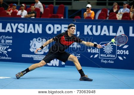 SEPTEMBER 23, 2014 - KUALA LUMPUR, MALAYSIA: Jarkko Nieminen of Finland makes a forehand return in his first round match at the Malaysian Open Tennis 2014 event. This is an ATP sanctioned tournament.