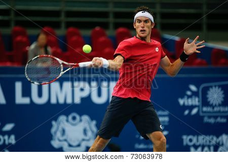 SEPTEMBER 25, 2014 - KUALA LUMPUR, MALAYSIA: Leonardo Mayer of Argentina makes a forehand return in his match at the Malaysian Open Tennis 2014. This is an ATP sanctioned tournament.