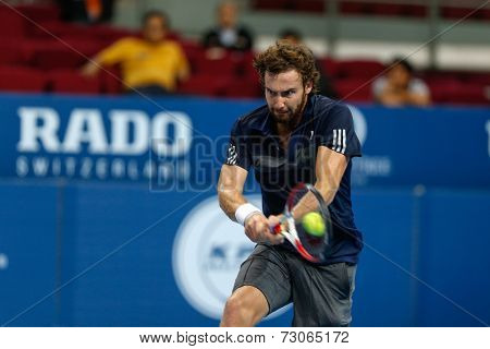 SEPTEMBER 25, 2014 - KUALA LUMPUR, MALAYSIA: Ernests Gulbis of Latvia makes a backhand return in his match at the Malaysian Open Tennis 2014. This is an ATP sanctioned tournament.