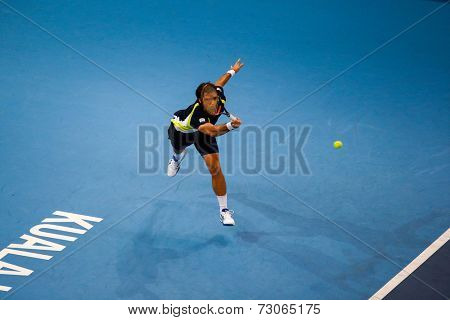SEPTEMBER 25, 2014 - KUALA LUMPUR, MALAYSIA: Pablo Andujar of Spain makes a forehand return in his match at the Malaysian Open Tennis 2014. This is an ATP sanctioned tournament.