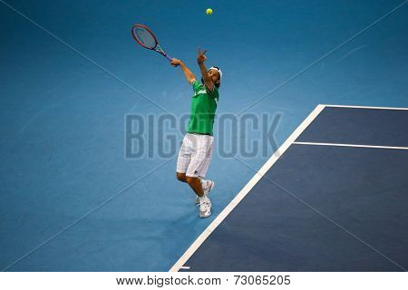 SEPTEMBER 25, 2014 - KUALA LUMPUR, MALAYSIA: Philipp Petzchner of Germany tosses the ball to serve in his match at the Malaysian Open Tennis 2014. This is an ATP sanctioned tournament.