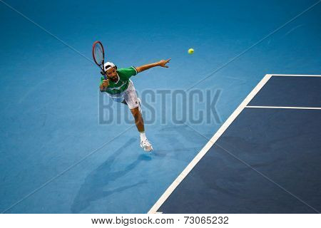 SEPTEMBER 25, 2014 - KUALA LUMPUR, MALAYSIA: Philipp Petzchner of Germany stretches to make a forehand return in his match at the Malaysian Open Tennis 2014. This is an ATP sanctioned tournament.