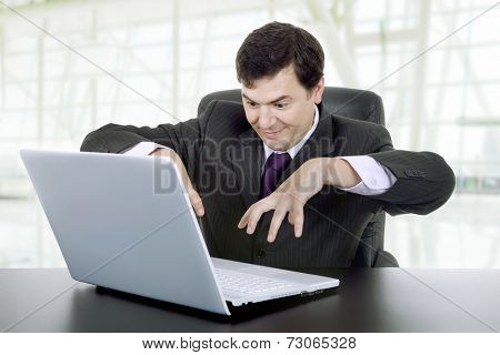 businessman working with is laptop at the office