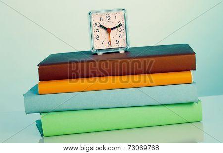 Alarm clock and color books
