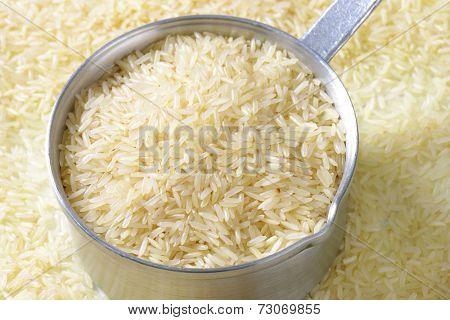 Uncooked Jasmine rice in a saucepan
