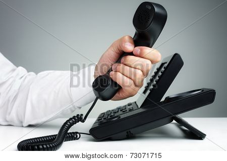 Businessman on business landline telephone in an office concept for communication, contact us and customer service support