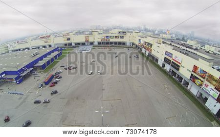 MOSCOW, RUSSIA - NOVEMBER 21, 2013: Parking lot next to a large shopping center Golden Babylon, aerial view.