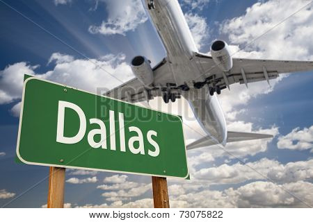 Dallas Green Road Sign and Airplane Above with Dramatic Blue Sky and Clouds.