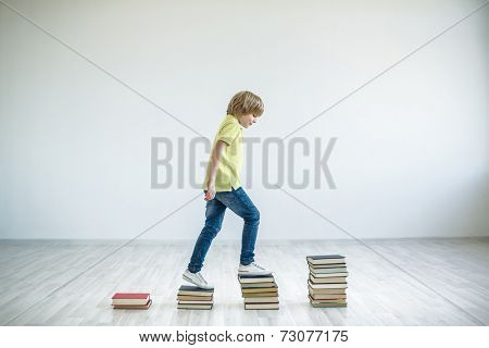Walking boy with books