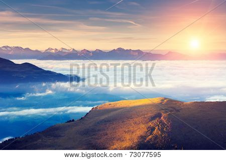 Great view of the foggy Val Gardena valley. National Park Odle �?�¢?? Geisler. Dolomites, South Tyrol. Location Ortisei, S. Cristina and Selva Gardena. Italy, Europe. Dramatic scene. Beauty world.