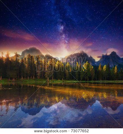 Lago Di Antorno in Natural park Tre Cime di Lavaredo under starry light. Cadini di Misurina Range, Dolomites, South Tyrol. Location Auronzo, Italy, Europe. Astrophotography. Beauty world.