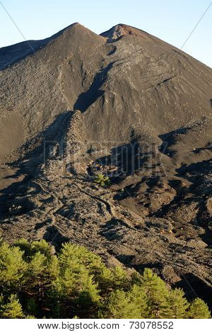 small volcanic cone of De Fiore Mount and cooled lava flow (sciara) of the 1974 eruption in Etna National Park, Sicily