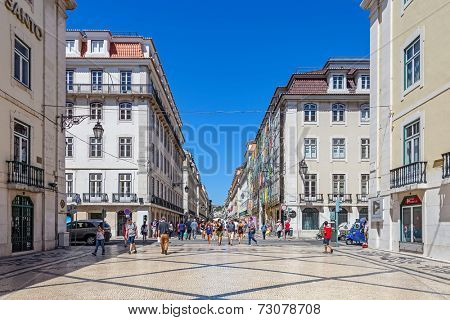 Lisbon, Portugal. August 31, 2014: Augusta Street in the Downtown District, known as Baixa. Considered as the most cosmopolitan street of the capital, is permanently filled with Lisboans and tourists
