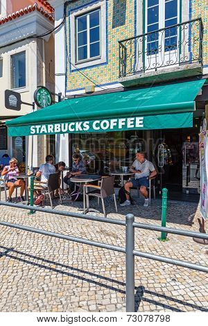 Lisbon, Portugal. August 24, 2014: The Belem Starbucks coffee house and esplanade  in Lisbon.