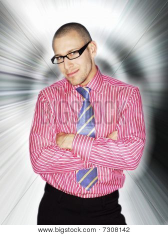 Business man in glasses smiling in front of light effect