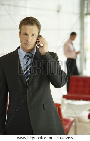 Businessman in Office Using Cell Phone