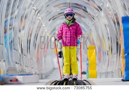 Skiing, young skier on ski lift, ski moving walkway