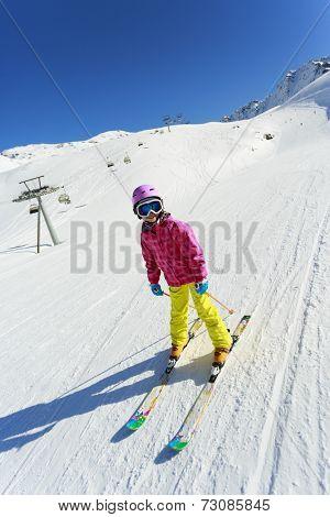 Skiing, skier on ski run - child skiing downhill