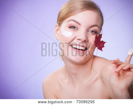Skin Care. Face Of Young Woman Girl With Red Maple Leaf.