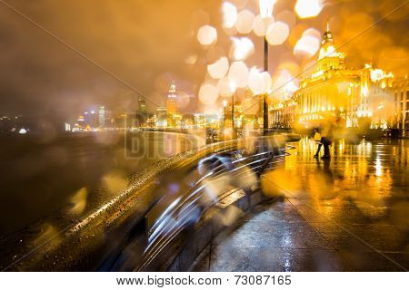 night view at shanghai china, huangpu river and bund.blur in the rain.