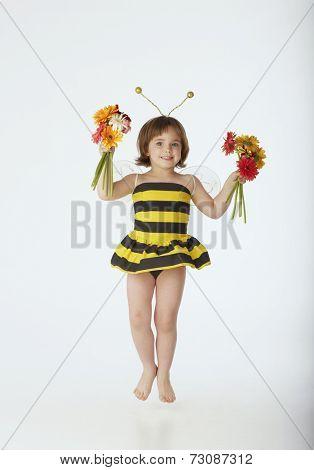 Jumping girl in bumblebee costume