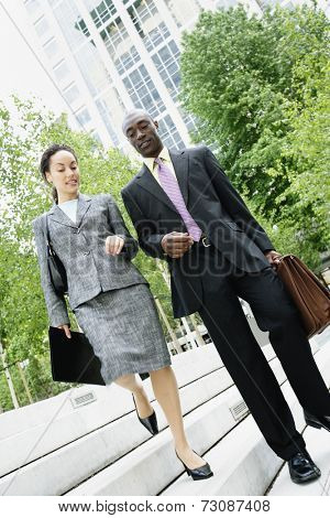 Businesspeople descending steps together