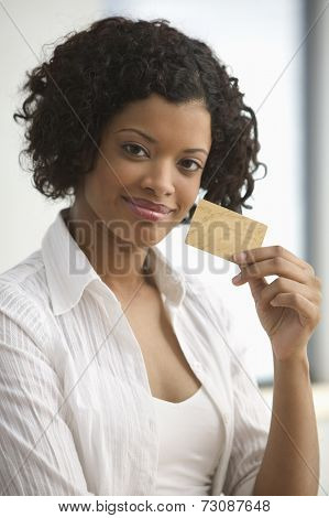 Portrait of woman holding a credit card