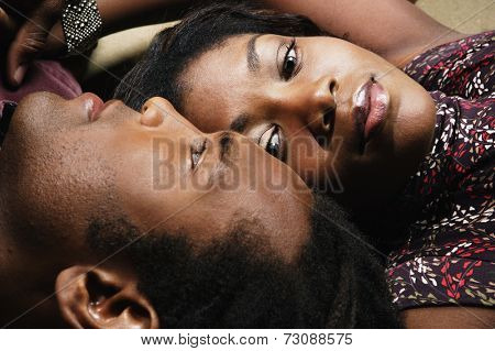 Close up of couple laying head to head