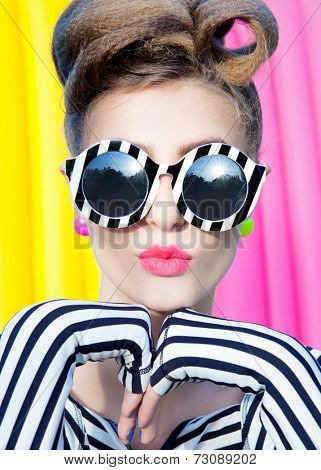 Colorful portrait of young attractive  woman wearing stripy sunglasses