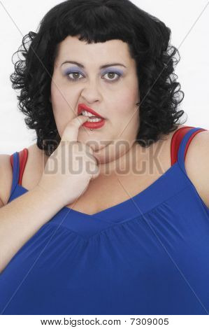 Overweight Woman Curling Lip and biting finger portrait