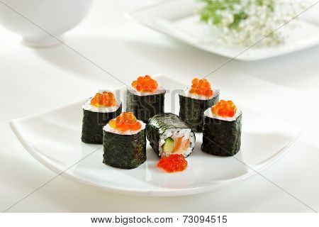 Sake Maki Sushi - Roll with Fresh Salmon and Cucumber inside. Topped with Salmon Caviar