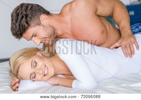 Close up Smiling Sweet Sexy Caucasian Couple Lying on White Bed.