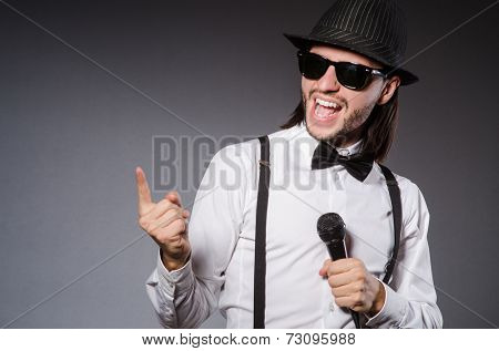 Funny singer with microphone at the concert