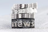 picture of newspaper  - the word news written with lead letters - JPG