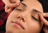 pic of eyebrow  - Massage the eyebrows of a young woman - JPG