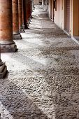 foto of porphyry  - dirty alley in the old town with pavement of porphyry cobblestones - JPG