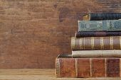 picture of leather-bound  - old books on wooden shelf - JPG
